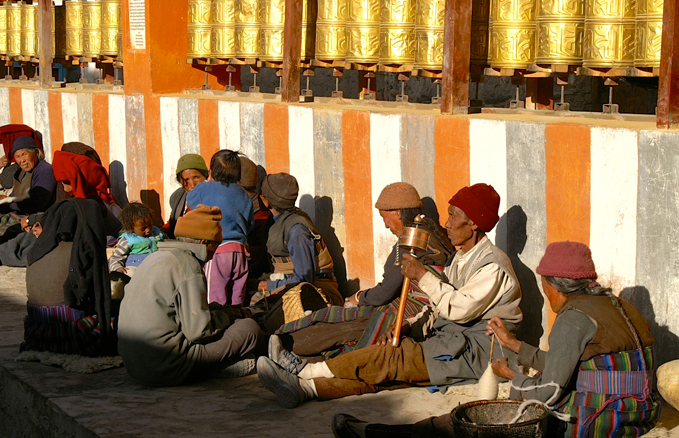 Lo Manthang, Upper Mustang, Nepal: This is the equivalent to the Italian evening passeggiata. People gather after work has finished to catch the sun, talk, and a little spinning…