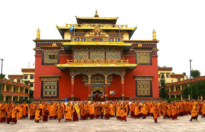 Shechen Ghompa, Boudhanath, Kathmandu, Nepal: Monks spill out into the courtyard after evening prayers. Tibetans are tolerated in Nepal, but they are coming under increasing pressure because China is leaning on the Nepal Government.